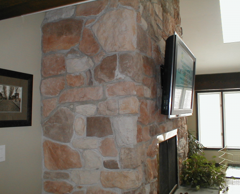 Wall TV Installation Above Brick Fireplace
